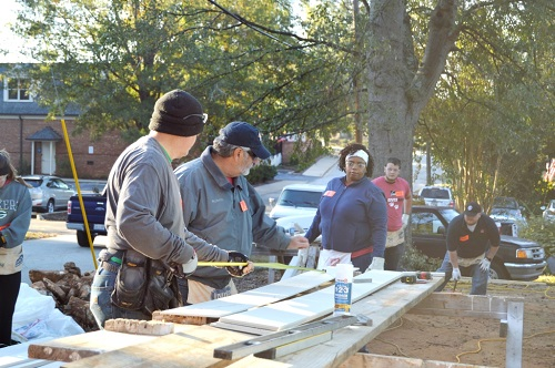Owens Corning volunteers work on the Habitat Spartanburg Drayton sites.
